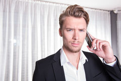 Portrait angry young business man in suit on the phone Stock Photo