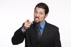 Portrait of an angry young businessman pointing towards camera Royalty Free Stock Photo