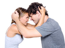 Portrait of the angry young couple. Isolated over white background Stock Photos