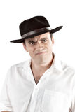 Portrait of angry young man in black hat. Royalty Free Stock Photography