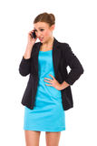 Portrait of angry young woman talking on smart phone. Royalty Free Stock Image