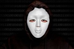 Portrait of anonymous man with white mask isolated on black. Background stock photography