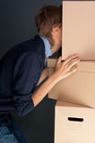 Portrait of anonymous young man. With his head inside box royalty free stock images