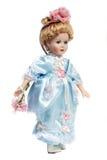 Portrait of antique porcelain doll face. Portrait of retro porcelain doll face with blue dress Stock Photography