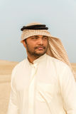 A portrait of an arab man. In the middle of the desert Stock Image