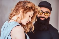 Portrait of an Arabian bearded male and beautiful redhead girl. stock image