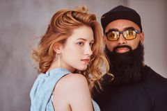 Portrait of an Arabian bearded male and beautiful redhead girl. stock photos