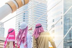 Portrait of arabian engineer talking about construction job with commitment to success standing in downtown with building. Background royalty free stock images