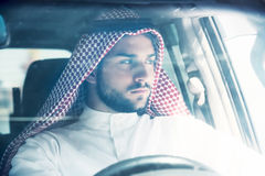 Portrait of arabian man driving a car stock image