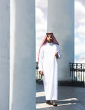 Portrait of a arabian man walking among the columns stock photo