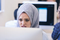 Portrait of Arabian woman looks angry while working on laptop Stock Photo