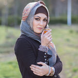 Portrait of an arabian woman. Portrait of a young woman, wearing arabian scarf Royalty Free Stock Photography