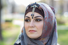 Portrait of an arabian woman. Portrait of a young woman, wearing arabian scarf Stock Photos