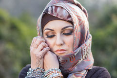 Portrait of an arabian woman. Portrait of a young woman, wearing arabian scarf Stock Images