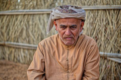 Portrait of Arabic man. In traditional clothing and headgear outdoors Stock Photo