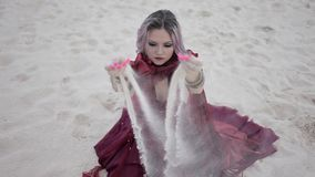 Portrait in Arabic style. Beautiful woman pours sand from hands. stock video footage