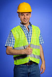 Portrait of architect in coveralls and hardhat showing thumbs up Stock Photography