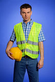 Portrait of architect in coveralls holding hardhat Royalty Free Stock Photo