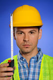 Portrait of architect in hardhat holding tape measure Royalty Free Stock Photography