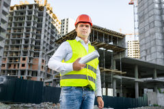 Portrait of architect in hardhat posing on building site Stock Image