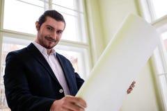 Portrait of architect holding blueprint Royalty Free Stock Photos