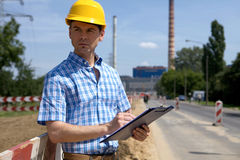 Portrait of architect holding clipboard and looking away Royalty Free Stock Photos