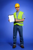 Portrait of architect holding clipboard and showing thumbs up sign Royalty Free Stock Photos
