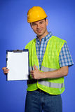 Portrait of architect holding clipboard and showing thumbs up sign Royalty Free Stock Photo