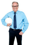 Portrait of an architect holding a safety helmet. Portrait of a confident senior male architect holding safety helmet Stock Photos