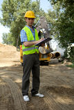 Portrait of architect using clipboard at construction site Royalty Free Stock Photos