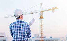 Portrait of architect wear white helmet safety hold the blueprint Stock Photography