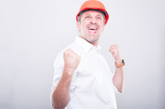 Portrait of architect wearing hardhat making success gesture Royalty Free Stock Images