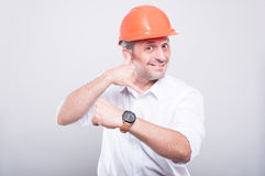Portrait of architect wearing  hardhat showing calling gesture Stock Photos