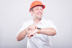 Portrait of architect wearing  hardhat showing wrist watch Royalty Free Stock Photography