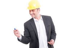 Portrait of architect wearing hardhat writing with marker Royalty Free Stock Images