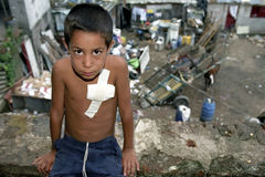 Portrait Argentine boy living on garbage dump. ARGENTINA, city of Buenos Aires: portrait of a Argentine boy, child, in his shabby living conditions, in the slum Stock Image