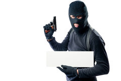 Portrait of an armed man in black clothes with a poster. On a white background Royalty Free Stock Photos