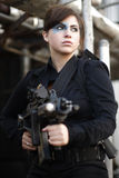Portrait of an armed woman Stock Image
