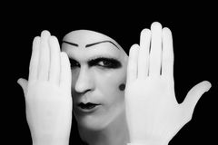 Portrait of  artful peeping mime in white gloves Stock Photo