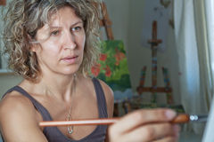 Portrait of the artist who paints. Royalty Free Stock Image