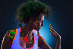 Portrait of artistic dancer with bright uv makeup. Close-up stock photos