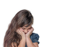 Portrait of ashamed little girl isolated on the white background Stock Image