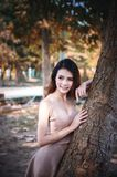 Asia beautiful woman lying tree in park royalty free stock photo