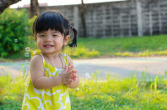 Portrait of asia children playing in the garden Royalty Free Stock Images