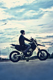 Portrait of asia handsome man biker on the motorcycle Royalty Free Stock Photo