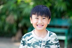 Portrait of Asia kid boy smiling with teeth and gums. Concept happy kid with nature Stock Images