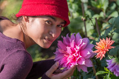 Portrait of asia woman and pink dahlia flower Royalty Free Stock Images