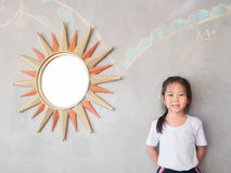 Portrait of Asian adorable little girl with the mirror Royalty Free Stock Images