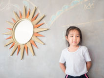 Portrait of Asian adorable little girl with the mirror Royalty Free Stock Image