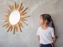 Portrait of Asian adorable little girl with the mirror Royalty Free Stock Photo